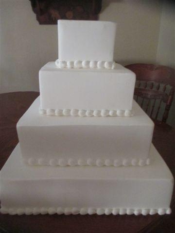 Square Tier Decorative Trimmed Cake