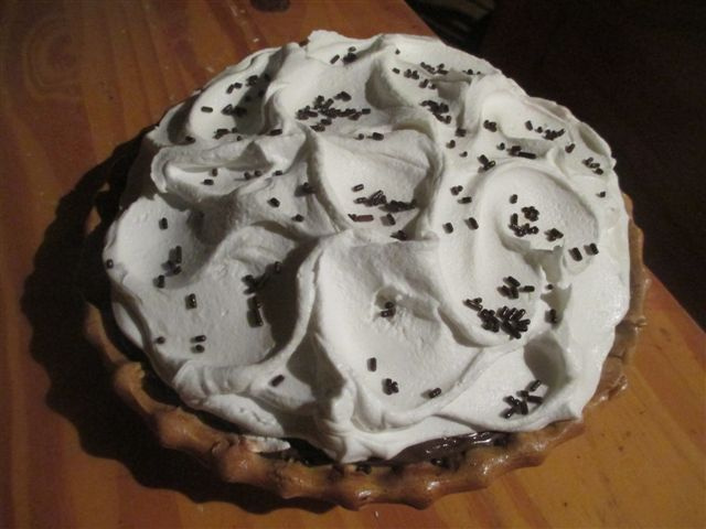 Chocolate bits topped Designed Whipped Cream Pie