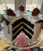 Dark Chocolate Cake with Slice out and Chocolate Drizzle