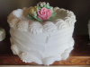 White Designed cake with Pastel Flowers